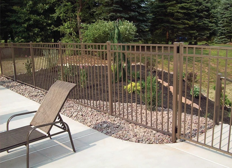 aluminum fencing with landscaped area