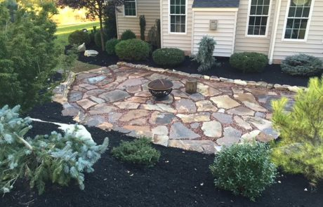 stone path with a fire pit