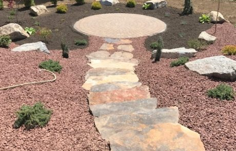 stone stairway to brick paver patio