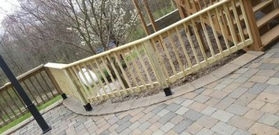 wooden railings by patio