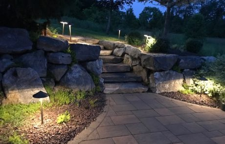 paver patio with stone stairway & outdoor lighting