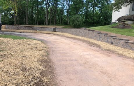 dirt road along a stone retaining wall