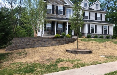 stone retaining wall in front of house